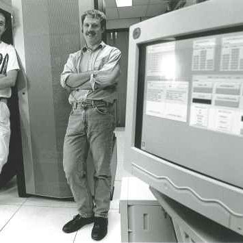 Griffith staff members (at the time) Dr Rok Sosic (left) and Associate Professor David Abramson with the Supercomputer